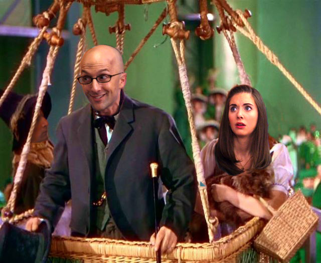 Dean Pelton as the Wizard, with Annie-Dorothy and Toto, in the basket of the balloon